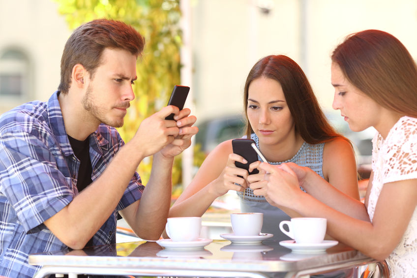 group of people using smartphone